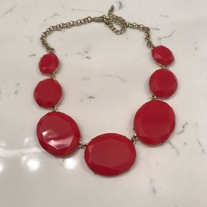 Red linked statement necklace.